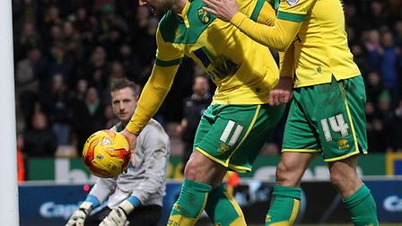 Gary Hooper claimed the matchball with a hat-trick in Norwich City's 4-0 Championship romp over Blac