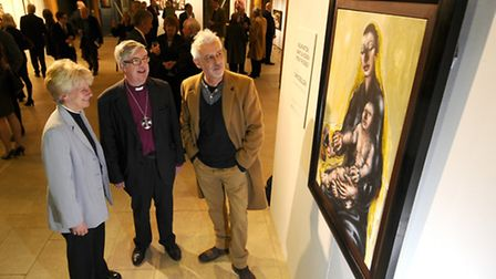 Artist Chris Gollon at his exhibition at Norwich Cathedral Hostry with the Dean of Norwich, The Revd