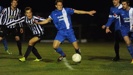 It's neck and neck between Dereham, black and white, and Wroxham to squeeze into the Ryman North pla
