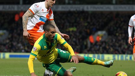 Lewis Grabban is sent tumbling by Blackpool's Peter Clarke to concede a penalty in Norwich's 4-0 Cha
