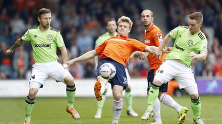 Luton Town's Cameron McGeehan in action with Forest Green's Matt Taylor and Jason Walker (R) Picture
