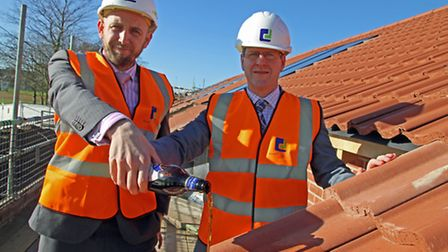 Richard Dove (left) and John Archibald celebrate the topping out of new sheltered accommodation at P