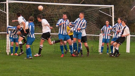 Swaffham Town, black and white, in football action earlier this season. Picture: EDDIE DEANE