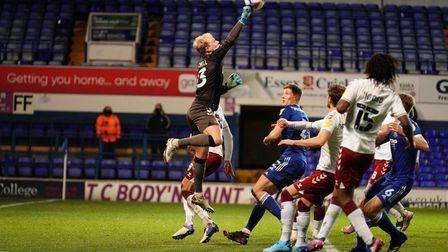 Northampton keeper Jonathan Mitchell punches clear.