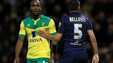 Norwich City's Cameron Jerome and Leeds United's Giuseppe Bellusci during the Championship match at