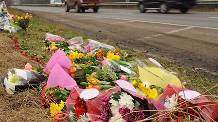 The floral tributes to the two women who died in the accident on the A11 southbound carriageway at B