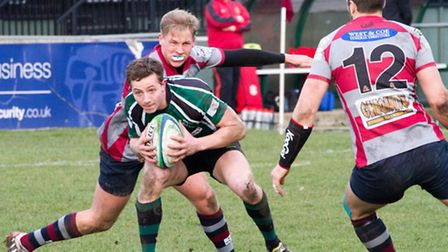Record points scorer Henry Dewing tries to force the North Walsham issue. Picture: HYWEL JONES