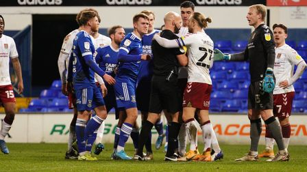 Ipswich players surround the referee after Alan Judges penalty appeal.