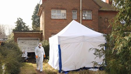 The tent up in the front garden of the victim's house in The Avenues, with the police forensic team