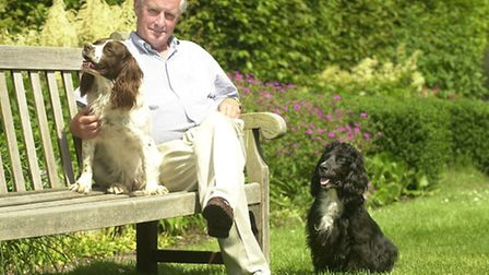 John Alston, High Sheriff of Norfolk, at home in his garden at Besthorpe Hall with dogs Sophie and C