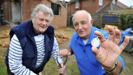 Frank Rush (right) of Wroxham was digging a soak-away in his garden and found a first world war meda