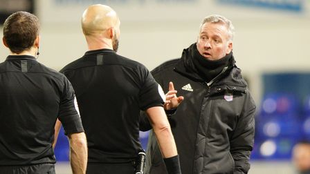 Town manager Paul Lambert waves his finger at referee Darren Drysdale as he has words after the matc