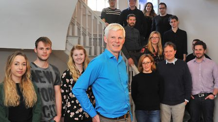 Anthony Hudson(centre) and the team at Hudson Architects in Norwich.Picture by SIMON FINLAY.