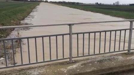 A teenager was found fishing in these choppy life-threatening flood waters at Whittlesey Dyke by volunteer bailiff Tony...