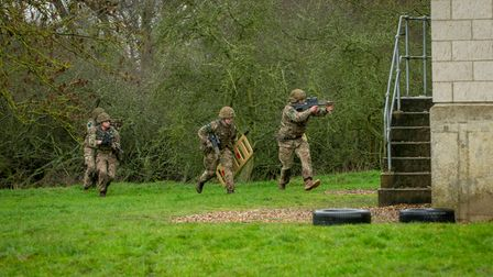 Members of 3rd Battalion, The Parachute Regiment assault a position.Balancing the need to maintain