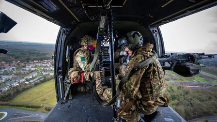 Members of The 3rd Battalion, The Parachute Regiment, on board a Puma helicopter, ready to assault a