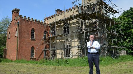 Roger Gawn outside a former bath house and watchtower in the grounds of Melton Constable Hall, which