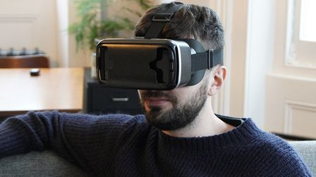 man wearing VR glasses as part of Essex university technology trials