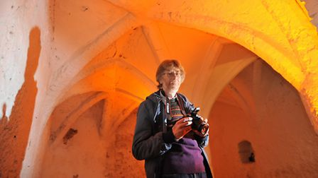 Terry George at The Guildhall undercroft, one of the many he is trying to photograph in Norfolk.Pict