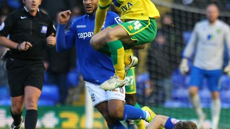 Wes Hoolahan avoids a tackle by Birmingham City's Jonathan Spector. Picture: Paul Chesterton/Focus I