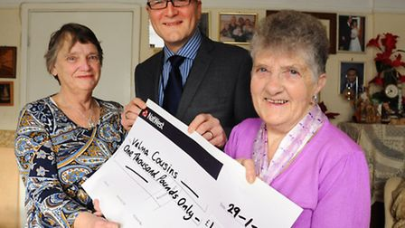 Velma Cousins, right, EDP winner of £1000 presented to her by David Galletly, Archant retail sales m
