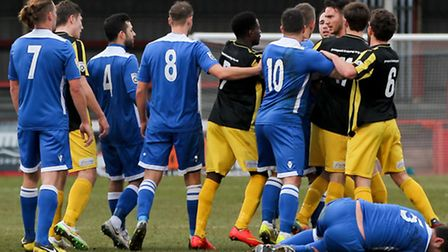 Gloucester City and Lowestoft Town players come to blows during the Conference North match at the Ab
