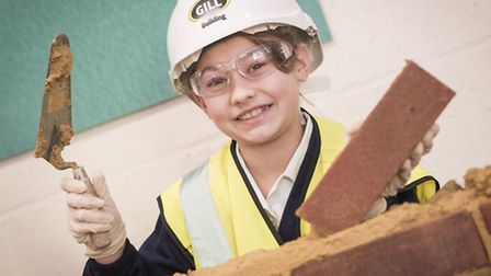 Pupils at Ashwicken Primary School got the chance to try their hand at brick laying, as part of the
