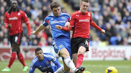 Cardiff City's Craig Noone and Hull City's Alex Bruce during the Barclays Premier League match at Th