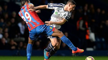 West Bromwich Albion's Graham Dorrans battles for the ball with Crystal Palace's Marouane Chamakh, d