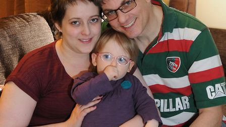 Becki Carey who was diagnosed with Hodgkin lymphoma pictured with her husband Grant and their daught