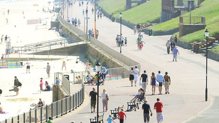 A busy beach and promenade at Gorleston. The lower prom has been opened to cyclists. Picture: James