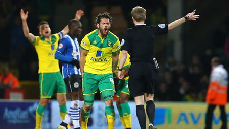 Bradley Johnson disagrees with a decision from referee Gavin Ward during the game against Wigan. Pic