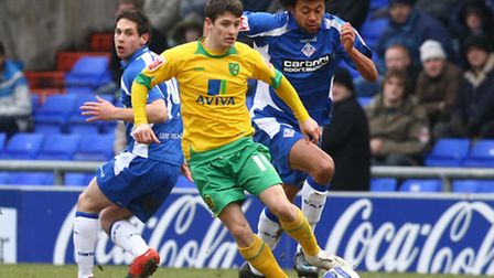 February 2010, Wes Hoolahan of Norwich and Jason Price of Oldham in action during the Coca Cola Lea