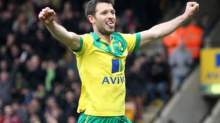 Wes Hoolahan of Norwich celebrates scoring his side's third goal from the penalty spot against Notti