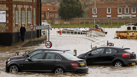 Spring High Tide at Blakeney Quay which flooded the car park surrounding several cars and The Quay r