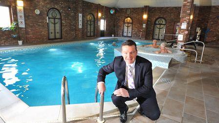 Holiday Inn Norwich North general manager Bill Heath with the refurbished swimming pool at the hotel
