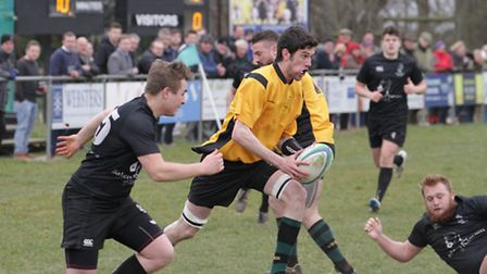 Action from North Walsham against Holt in the Woodforde's Norfolk Senior Cup semi-finals at Scottow.