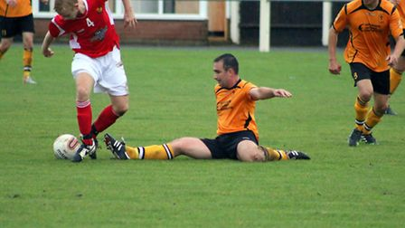 Stephen Harvey, grounded, in action for Fakenham Town. Picture: TONY MILES