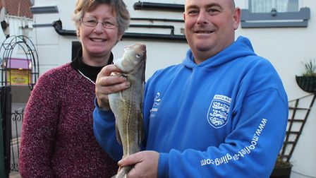 Norfolk Sea Angling Festival organiser Elaine Roe with John Brown of Southampton, who is pictured wi