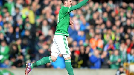 Northern Ireland's Norwich City striker Kyle Lafferty celebrates his second goal in his country's 2-