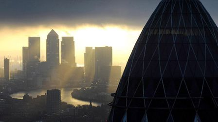 The 'Gherkin' and Canary Wharf. Photo credit should read: Stefan Rousseau/PA Wire