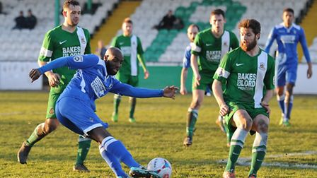 Bradley Woods-Garness of Lowestoft Town shoots narrowly wide during the Conference North match at Ho