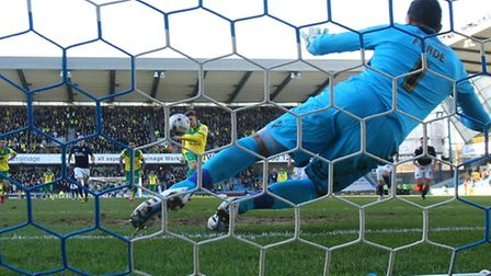 Gary Hooper slams home Norwich City's second in a 4-1 Championship win at Millwall. Picture by Paul