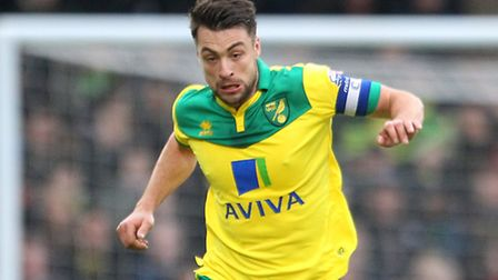 Russell Martin of Norwich City in action against Wolves during the Sky Bet Championship match at Car