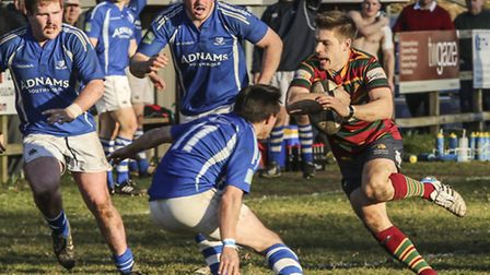 Action from Diss's 37-7 win against Norwich (red) at Mackenders, Ben Girling in action. Picture: And