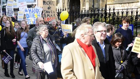George Nobbs, leader of Norfolk County Council, in a red scarf, at Saturday's protest march through