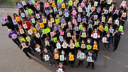 City of Norwich School pupils getting involved in Pi Day by holding a hundred digits in celebration