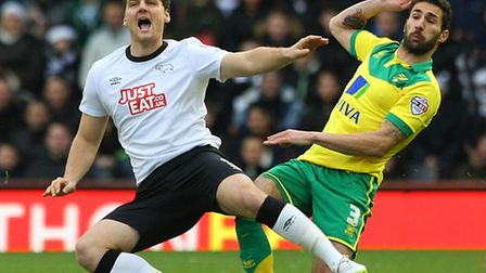 Chris Martin (left) battles with Carlos Cuellar during Derby's 2-2 draw with Norwich City in Decembe