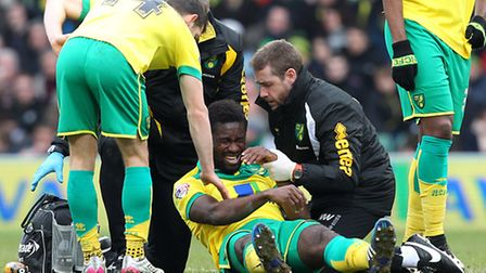 Alexander Tettey of Norwich receives treatment for a head injury during the Sky Bet Championship mat