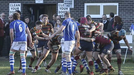 Action from Diss's 37-7 win against Norwich (red) at Mackenders, Stu Seppings sets up a maul, but mi